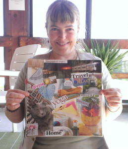Me with my latest vision board, created in a workshop at Life Rocks in June.
