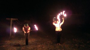 ElvenTiger (left) taught herself to spin poi, and now she lights her props on fire...