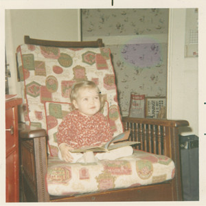 Me, reading and pondering, age 2.
